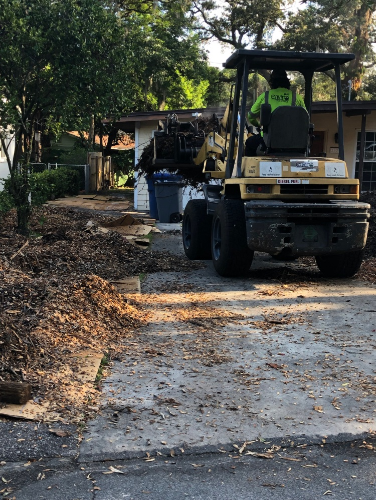 spreading truck load of wood chips